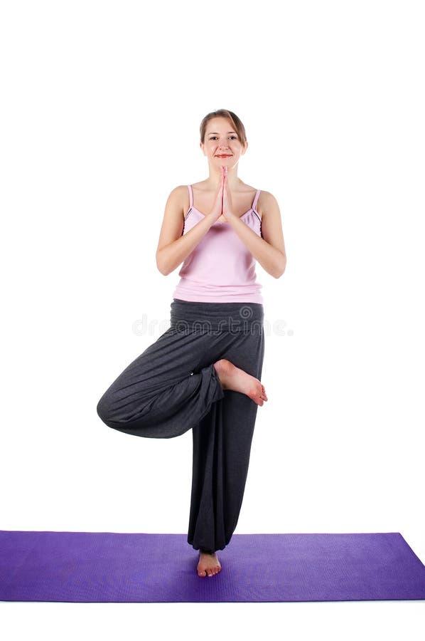 Le donne è agganciata nell'yoga immagini stock libere da diritti