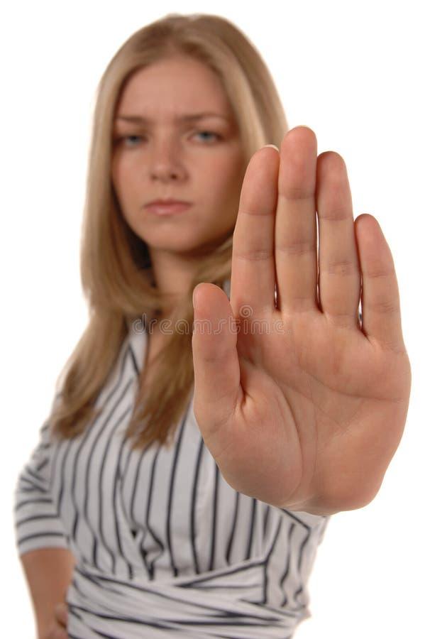 Le donne con la mano in su SI ARRESTANO fotografie stock libere da diritti