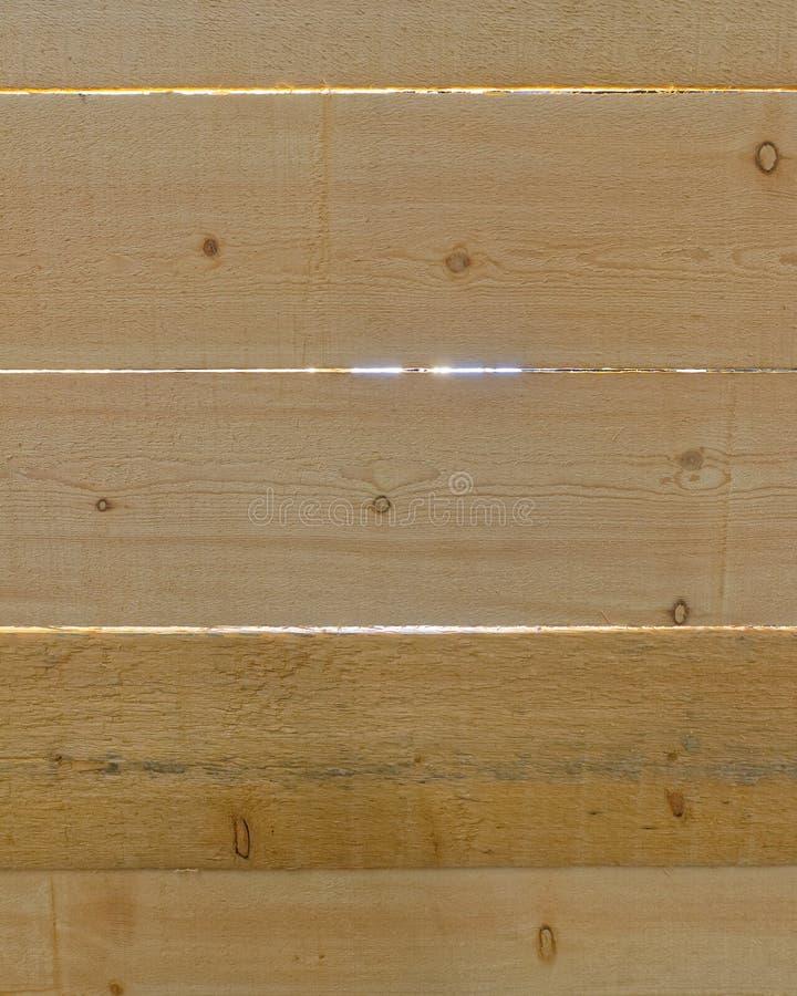 Le dos a allumé le plan rapproché en bois de planches image libre de droits