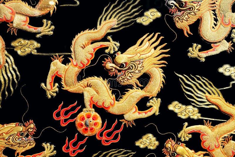 Le dragon de la broderie illustration de vecteur