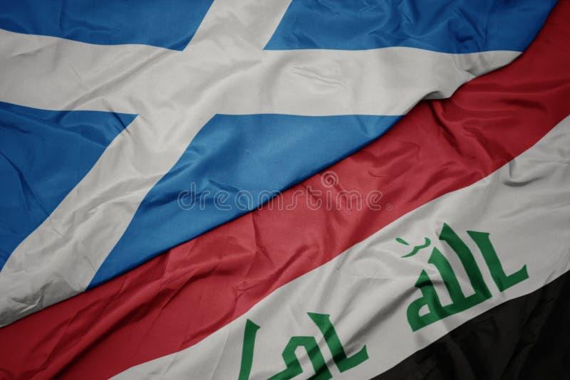 le drapeau coloré de l' irak et le drapeau national de l' écosse image stock