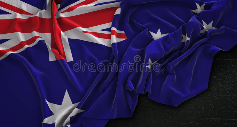 Le drapeau d'Australie a ridé sur le fond foncé 3D rendent illustration libre de droits