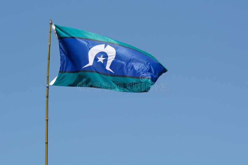 Le drapeau d'insulaire de détroit de Torres photographie stock