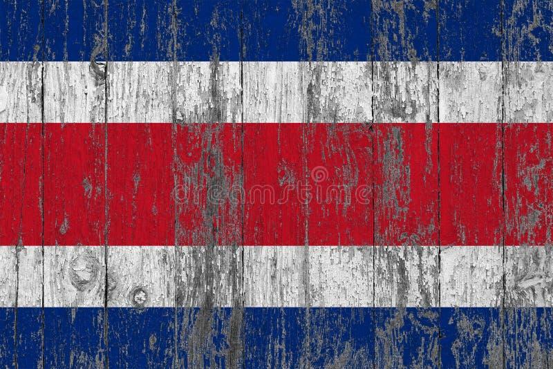 Le drapeau de Costa Rica a peint sur le fond en bois usé de texture photo stock