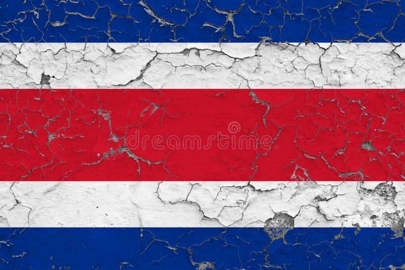 Le drapeau de Costa Rica a peint sur le mur sale criqué Mod?le national sur la surface de style de cru images stock