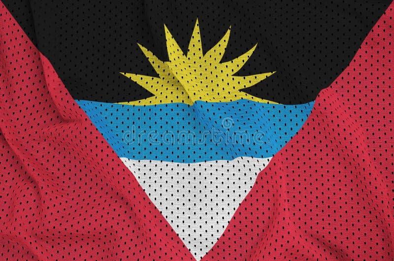 Le drapeau de l'Antigua-et-Barbuda a imprimé sur des vêtements de sport de nylon de polyester illustration libre de droits