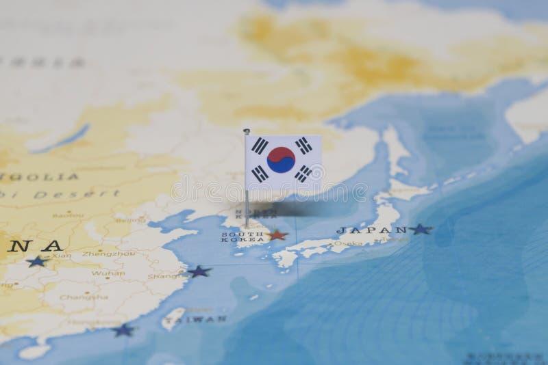 Le drapeau de la Corée du Sud dans la carte du monde images libres de droits