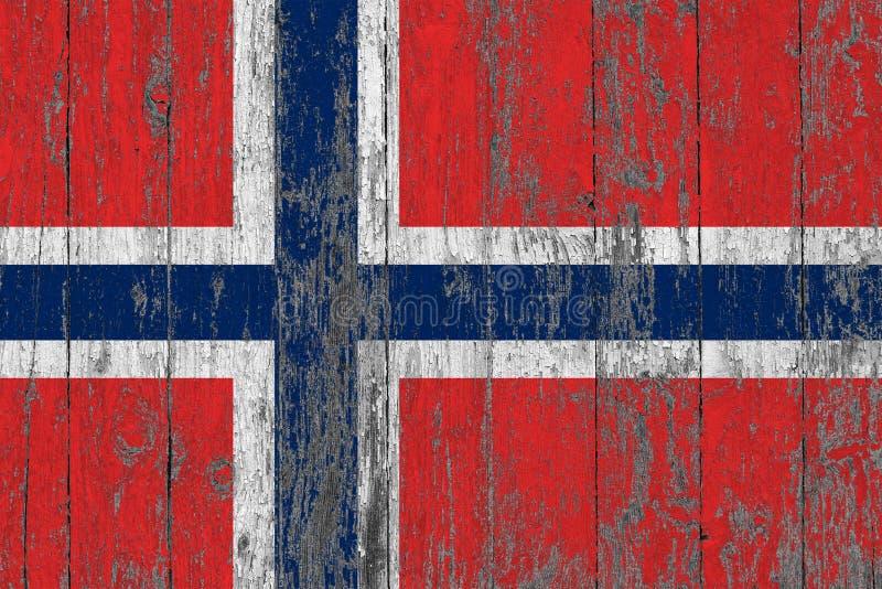 Le drapeau de la Norvège a peint sur le fond en bois usé de texture photo libre de droits