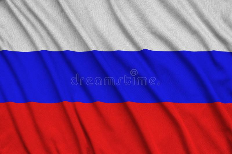Le drapeau de la Russie est dépeint sur un tissu de tissu de sports avec beaucoup de plis Bannière d'équipe de sport images libres de droits