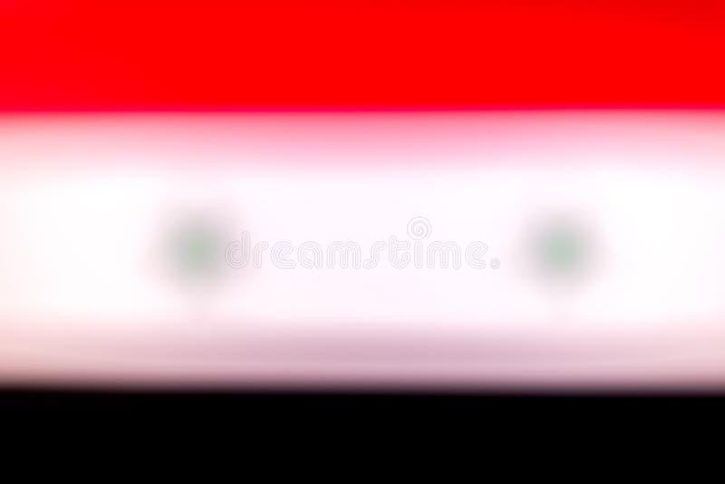 Le drapeau de la Syrie dans le defocus illustration libre de droits