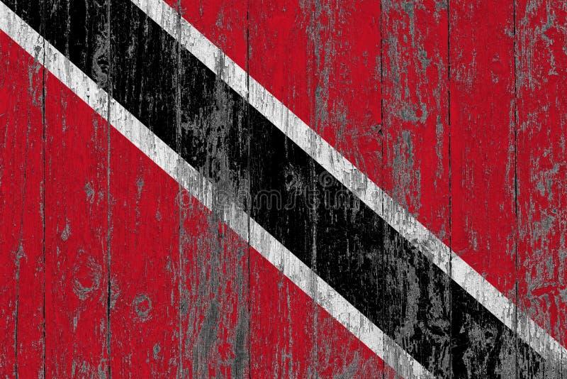 Le drapeau de Trinidad And Tobago a peint sur le fond en bois usé de texture photos stock