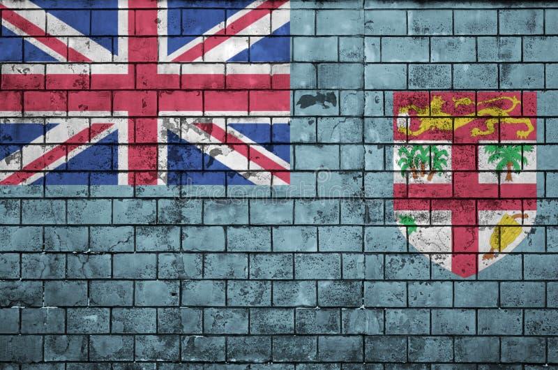 Le drapeau des Fidji est peint sur un vieux mur de briques photographie stock libre de droits