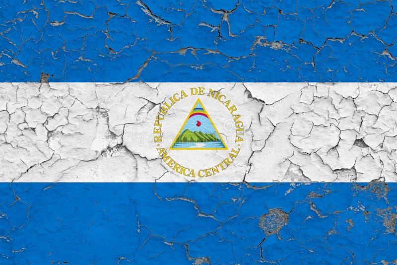 Le drapeau du Nicaragua a peint sur le mur sale criqué Mod?le national sur la surface de style de cru illustration stock