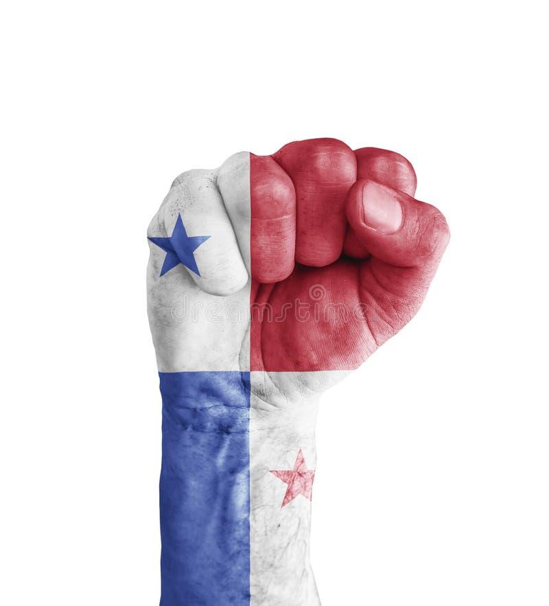 Le drapeau du Panama a peint sur le poing humain comme le symbole de victoire images libres de droits
