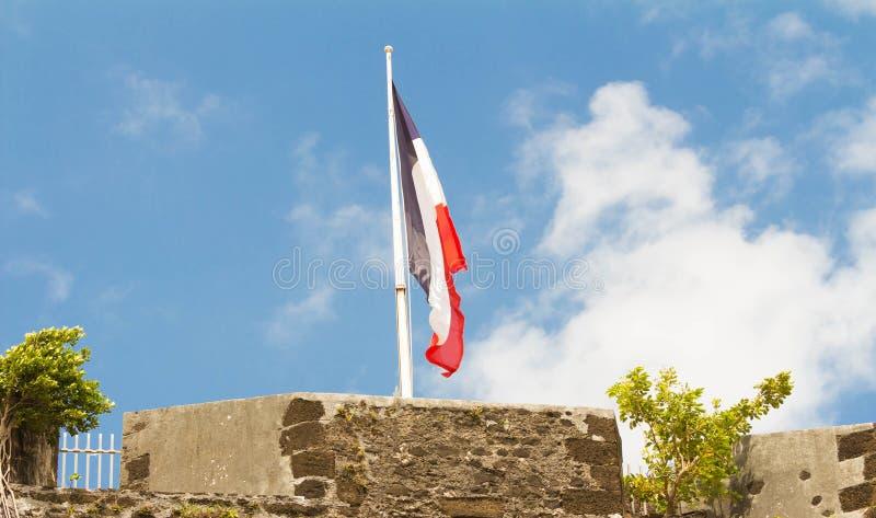 Le drapeau français levé sur un dessus de Saint Louis de fort, Martin photos libres de droits