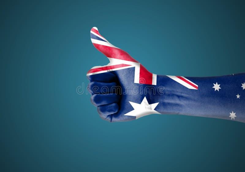 Le drapeau national de l'Australie a peint dans les mains des personnes avec le poing fermé célébrant le jour de l'Australie illustration stock