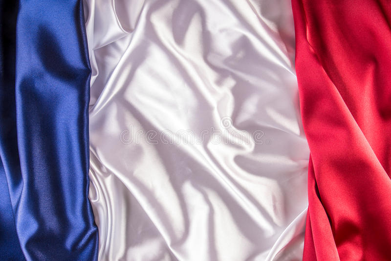 Le drapeau national français a composé du tissu coloré du satin trois photos stock