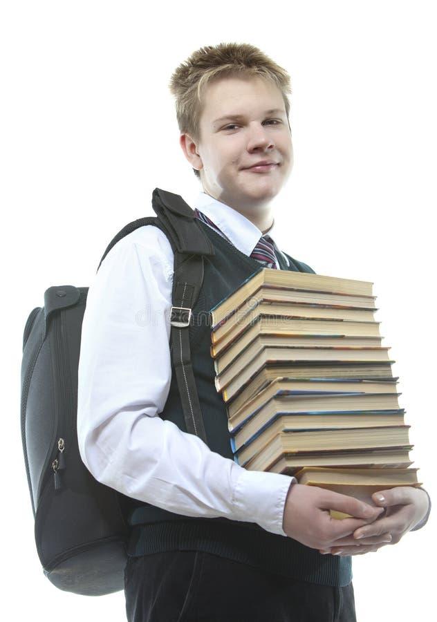Le eleven med läroböcker arkivfoto