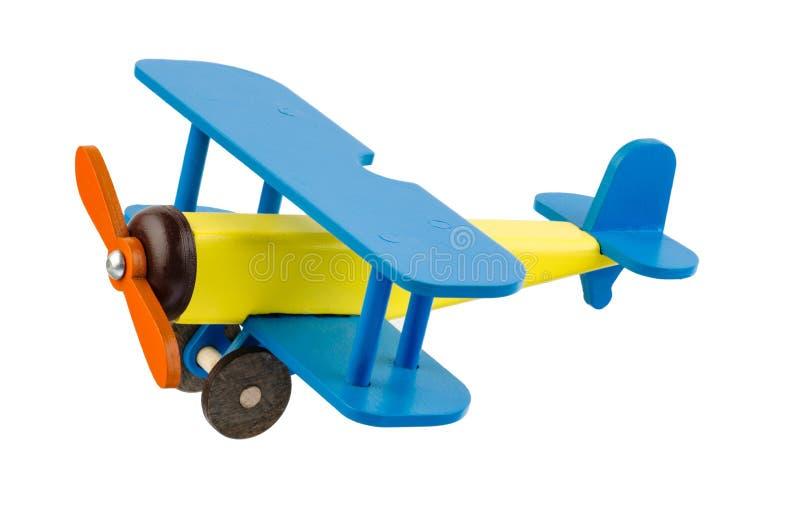 Le ` en bois s d'enfants a coloré l'avion d'isolement sur le fond blanc photos libres de droits