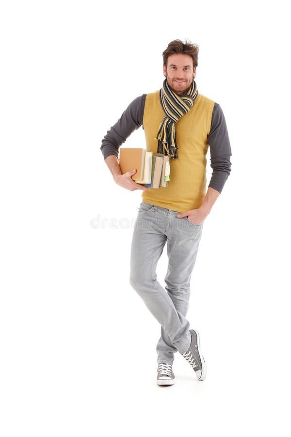 Le för böcker för universitetardeltagareholding royaltyfri foto
