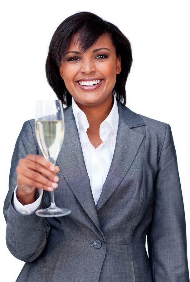 le för champagne för affärskvinna fira arkivfoton