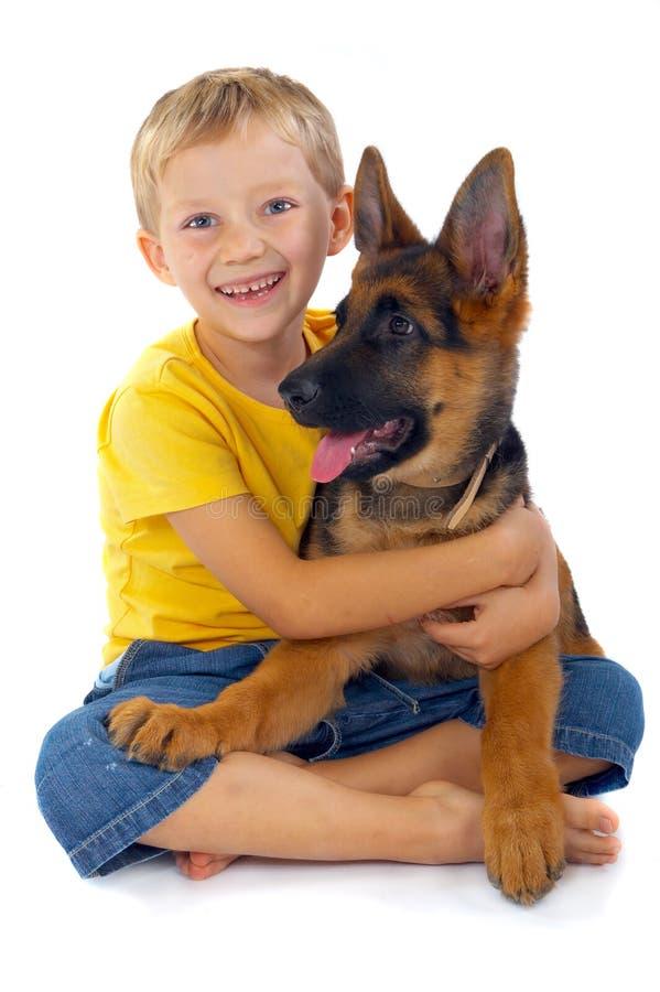 le för pojkehund royaltyfria foton