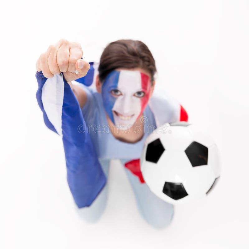 Le fan de foot femelle de l'équipe nationale de Frances encourage image libre de droits