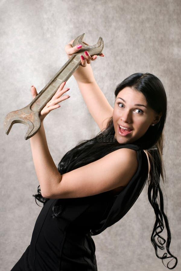 Le femme élégant avec une clé image stock