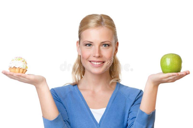 Le femme attirant effectue un choix image libre de droits