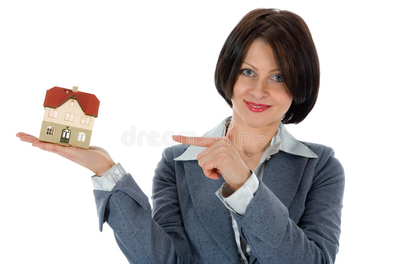Le femme d'affaires annonce les immeubles photo stock