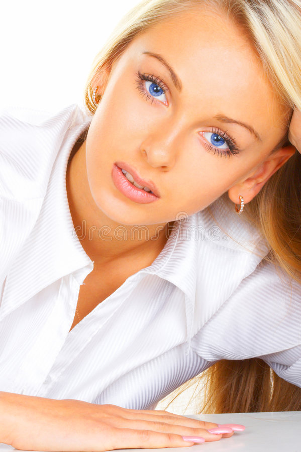 Le femme d'affaires avec des œil bleu photographie stock libre de droits