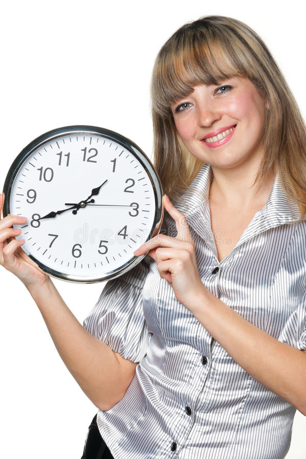 Le femme d'affaires avec l'horloge dans des mains photo stock