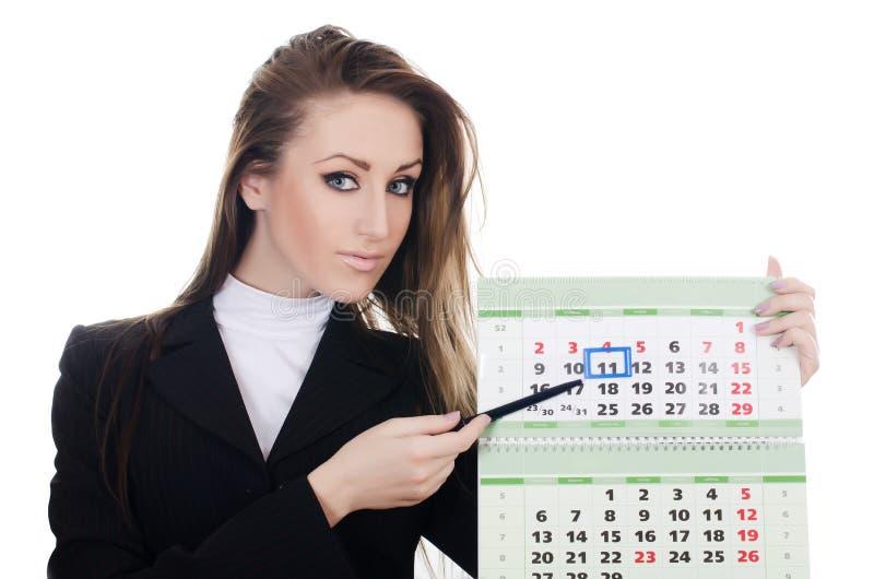 Le femme d'affaires avec un calendrier photographie stock