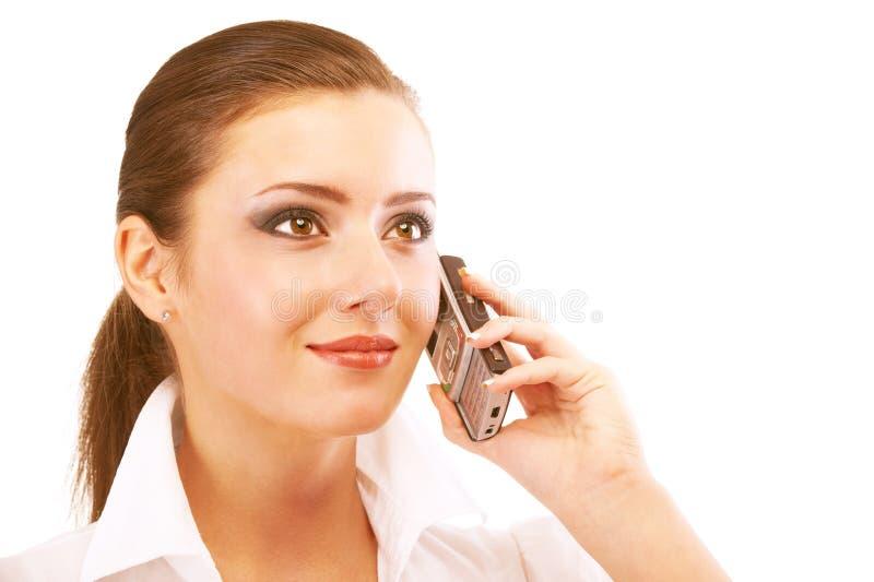 Le femme d'affaires parle du téléphone images stock