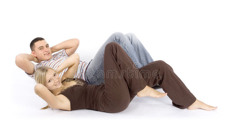 Le femme et l'homme s'exercent ensemble photographie stock libre de droits