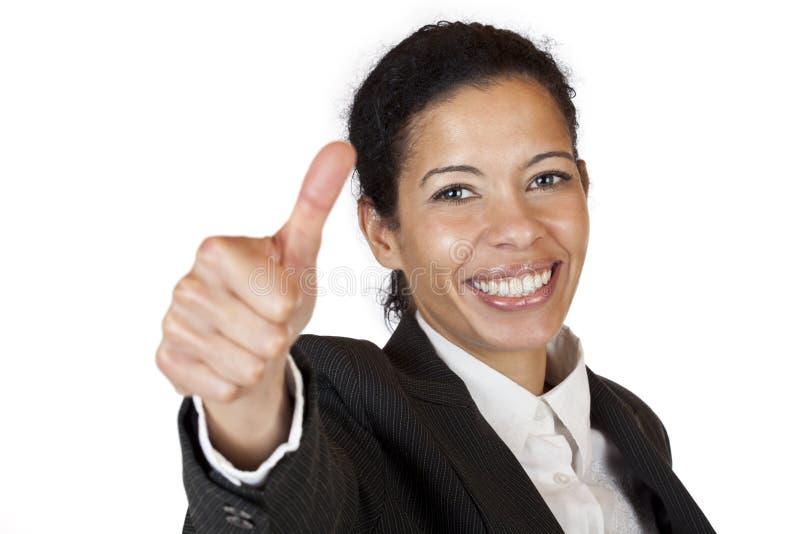 Le femme plein d'assurance d'affaires affiche le pouce vers le haut photo stock