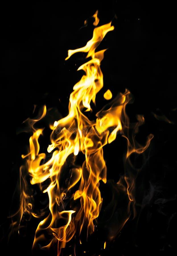 Le feu abstrait de flamme sur le fond noir photographie stock