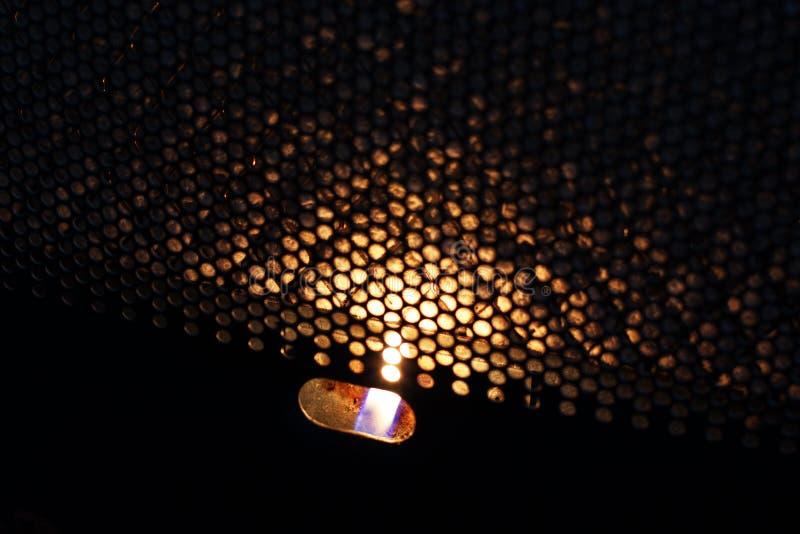 Le feu dans le convecteur heat photographie stock libre de droits