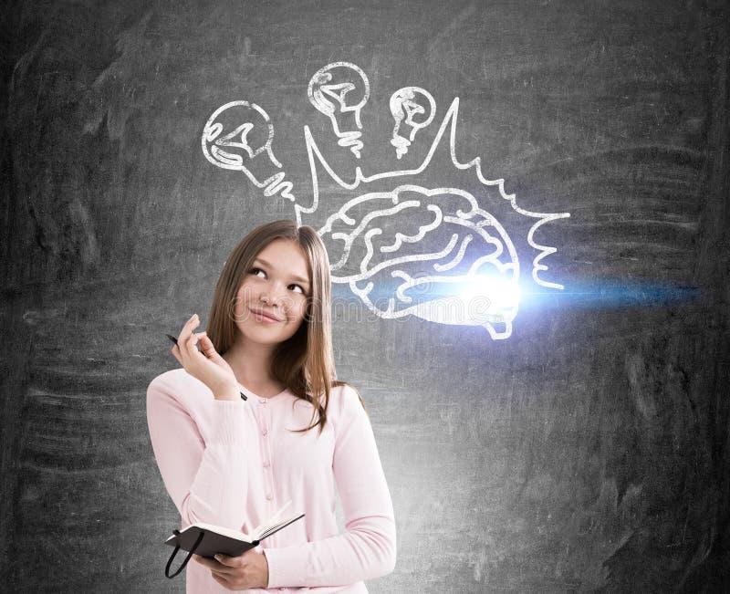 Le flickan och hjärnan med ljusa kulor arkivbild