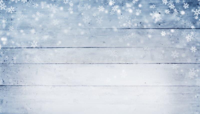 Le fond abstrait d'hiver avec les planches et la neige en bois s'écaille photo libre de droits
