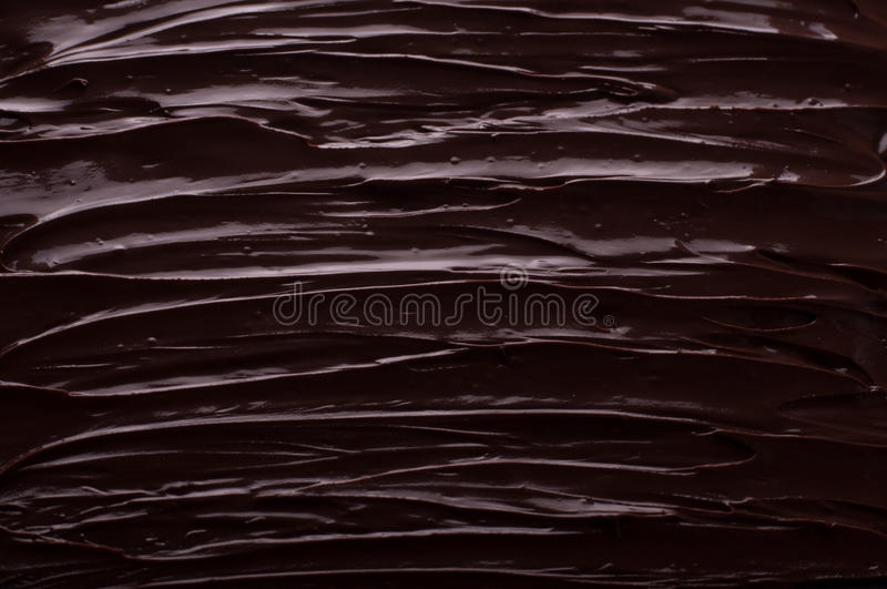 Le fond de chocolat ondule faisant cuire le concept - le chocolat fondu a photographie stock