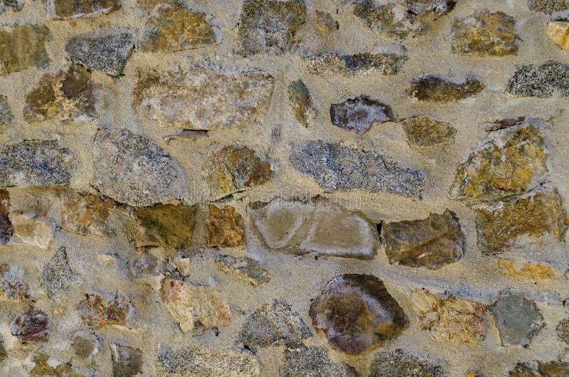 Le fond de mur en pierre de règne ville du Mali ou diplômé de Stari Mali image stock