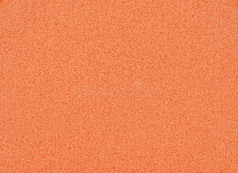 Le fond de texture d'éponge, étroits oranges vers le haut de la vue d'une éponge cosmétique ou protection pour le massage facial  image stock
