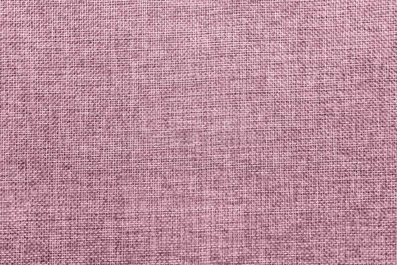Le fond de toile de jute a coloré dans pâle - mélange rose images libres de droits