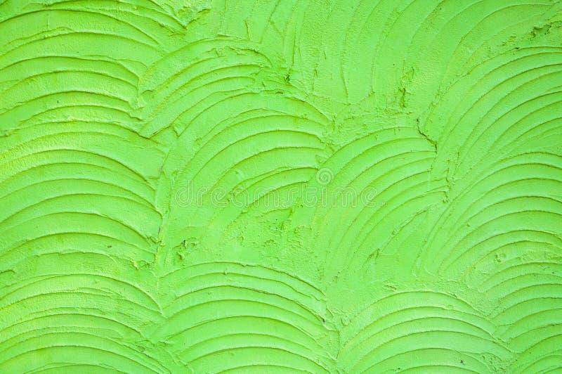 Le fond du mur vert de ciment est courbe de plâtre rugueuse photo libre de droits
