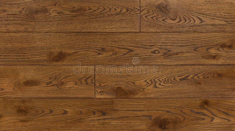 Le fond en bois de texture pour la conception, chêne a modifié la tonalité le conseil brun photo libre de droits