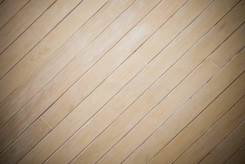 Le fond en bois en stratifié de texture de mur, centrent le projecteur, obscurcissent le bord, modèle diagonal photographie stock