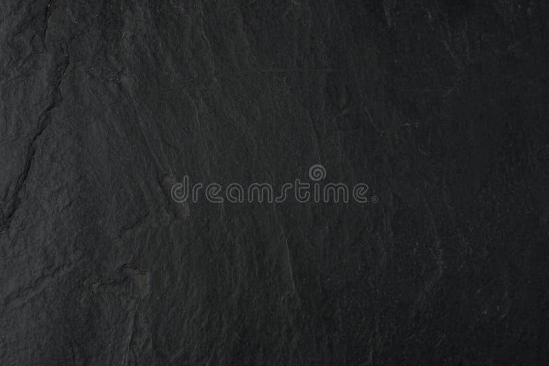 Le fond en pierre noir naturel de dessus de table images libres de droits