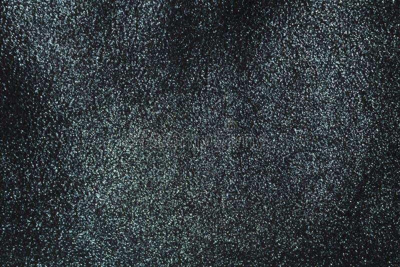 Le fond est un noir brillant profond avec le tissu argenté images stock