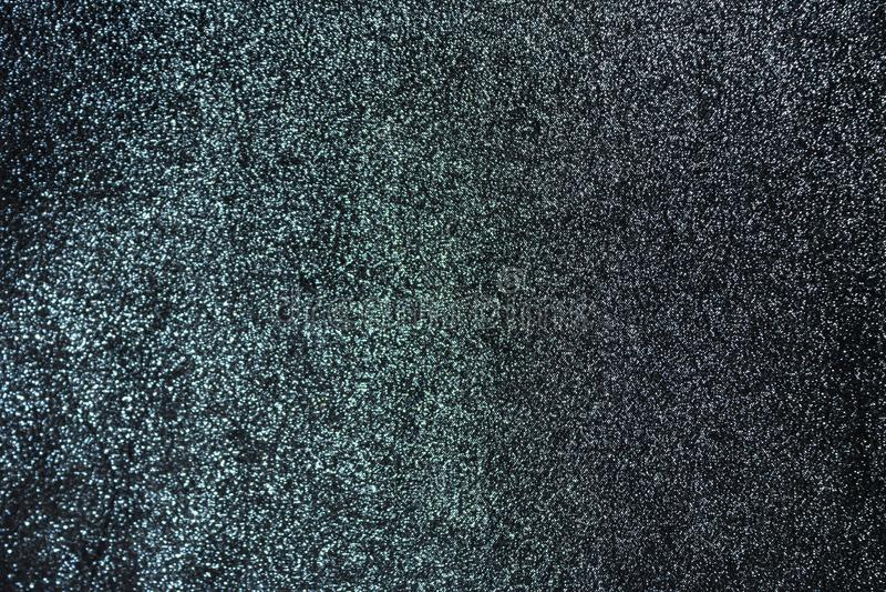Le fond est un vert brillant profond avec le tissu gris photographie stock libre de droits